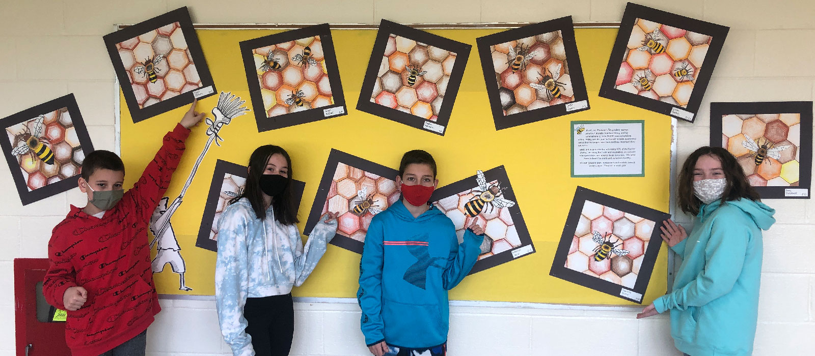 Students pictured with their art